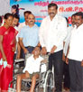 Napoleon Distributes assistive Devices to Differently-abled